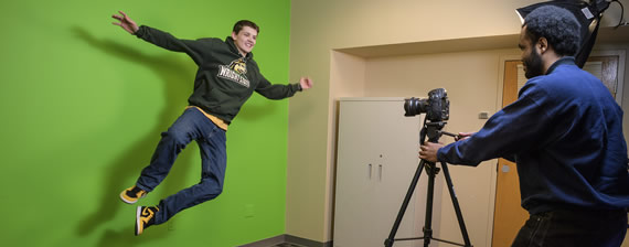 Students using the green screen in the STAC Studios